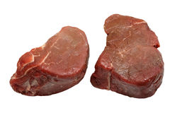 Fillet Steaks Raw. Two raw fillet steaks on an isolated white background with a clipping path Royalty Free Stock Image