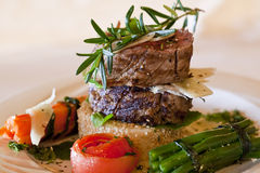 Fillet tower on Rosti. Tender fillet steak prepared on a pap rosti and side vegetables Royalty Free Stock Photography