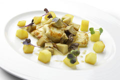 Fillet of turbot with mushrooms and potatoes Royalty Free Stock Images