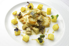 Fillet of turbot with mushrooms and potatoes Stock Photography