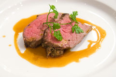 Fillet of Wagyu beef with sauce and chervil garnish Royalty Free Stock Image