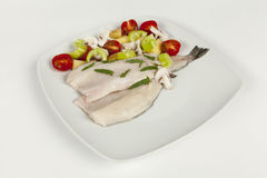 Fillet on a white plate and fresh vegetables Royalty Free Stock Photos