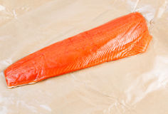 Fillet of Wild Sockeye Salmon in Wax Paper Stock Photography