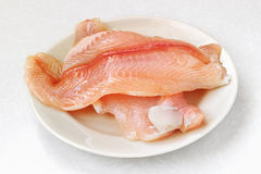 Filleted fish. On white plate Royalty Free Stock Image
