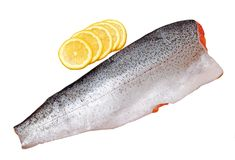Filleted salmon  and lime Royalty Free Stock Photos