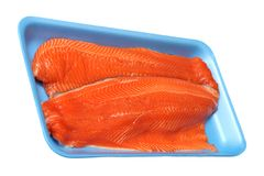 Filleted salmon. On tray isolated on white background Royalty Free Stock Photo