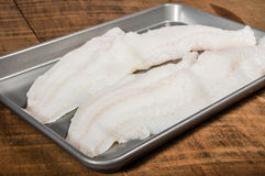 Fillets of cod fish on baking pan Stock Photography