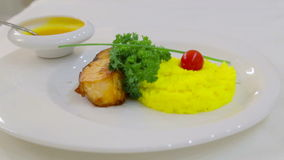Fillets fried fish with a side dish of rice.Boiled rice and fish fillets with sauce. stock footage