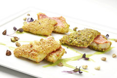 Fillets of red mullet in hazelnut crust peanuts and pistachios Royalty Free Stock Photo