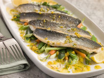 Fillets of Sea bass with Baby Vegetables Royalty Free Stock Image