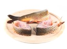 Fillets and tail raw carp on a wooden board. Stock Photo