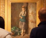Fillette mangeant des cerises. Watching the painting, Fillette mangeant des cerises, from Jules Breton, 1876 Stock Images