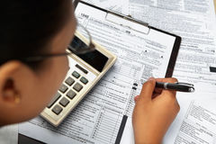 Filling 1040 tax form Stock Photo