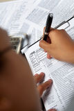 Filling 1040 tax form Royalty Free Stock Images