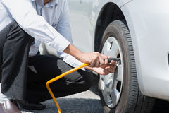 Filling air to the car tires. Royalty Free Stock Photography