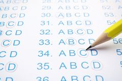 Filling answer sheet with pencil, closeup. View royalty free stock image