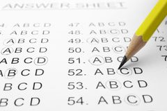 Filling answer sheet with pencil. Closeup view stock images