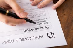 Filling application form. Human hand filling application form Royalty Free Stock Images