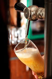 Filling beer glass and tap Royalty Free Stock Photos