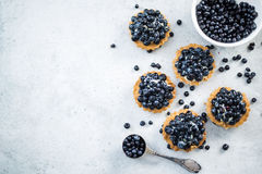 Filling blueberry tart with fresh fruits Stock Images
