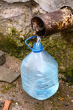 Filling  bottle by spring water Stock Photo