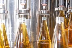 Filling bottles with juice. Bottling of drinks. bottling plant royalty free stock images
