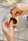Filling bread dough with chocolate. Chip Stock Images