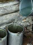 Filling bucket with water Stock Photography