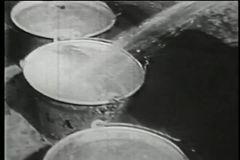 Filling buckets with water using hose, New York City, 1930s stock video footage