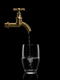 Filling By Water Of A Glass From Brass Faucet Royalty Free Stock Images