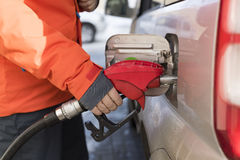 Filling the car with gasoline. At a gas station in the city Stock Photos