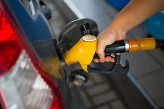 Filling the car with gasoline. Gasoline refueling vehicle and a hand Royalty Free Stock Image