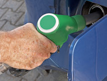 Filling car - petrol forecourt detail Royalty Free Stock Images