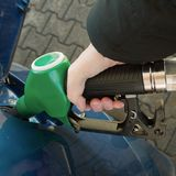 Filling car up with green fuel - square stock images