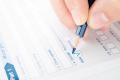 Filling checkbox in a questionnaire.  Stock Photos