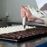 Filling chocolates. Royalty Free Stock Photo