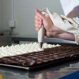 Filling chocolates. Royalty Free Stock Photo