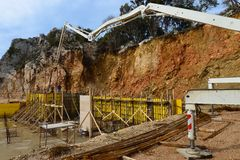 Filling in the concrete structure of the building walls by concrete pump Stock Photography