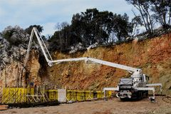 Filling in the concrete structure of the building walls by concrete pump Royalty Free Stock Photography