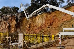 Filling in the concrete structure of the building walls by concrete pump Royalty Free Stock Photo