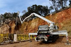 Filling in the concrete structure of the building walls by concrete pump Royalty Free Stock Images