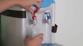 Filling Cup At Water Cooler, Water Dispenser. Woman . Full HD 1920 x 1080p, 29,97 fps stock video footage
