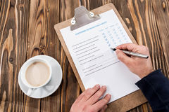 Filling In Customer Satisfaction Survey Royalty Free Stock Photo