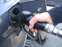 Filling diesel. Close up of man's hand filling diesel on his car Royalty Free Stock Photography