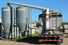 Filling Feed Bins. Feed supplier delivering grain to storage bins Stock Photo
