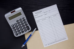 Filling the financial invoice Stock Image