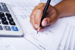 Filling financial report Royalty Free Stock Photo
