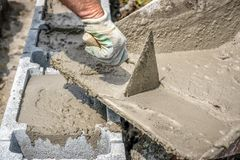 Filling foundation blocks with mortar Royalty Free Stock Image