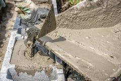 Filling foundation blocks with mortar Stock Photos
