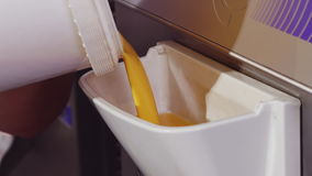 Filling freezer with fruit mix stock video